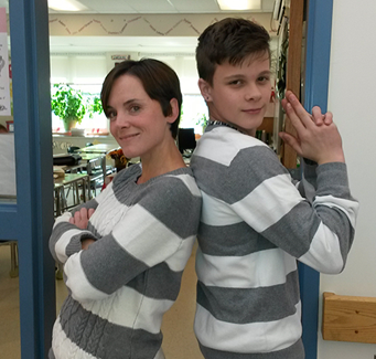 two people in matching grey and white stripped shirts