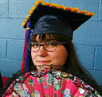 female graduating student with folding fan