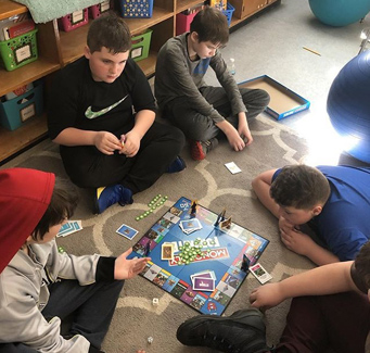 students playing Monopoly
