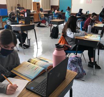 students doing bookwork