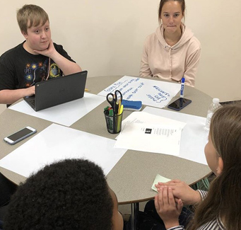 four students working together
