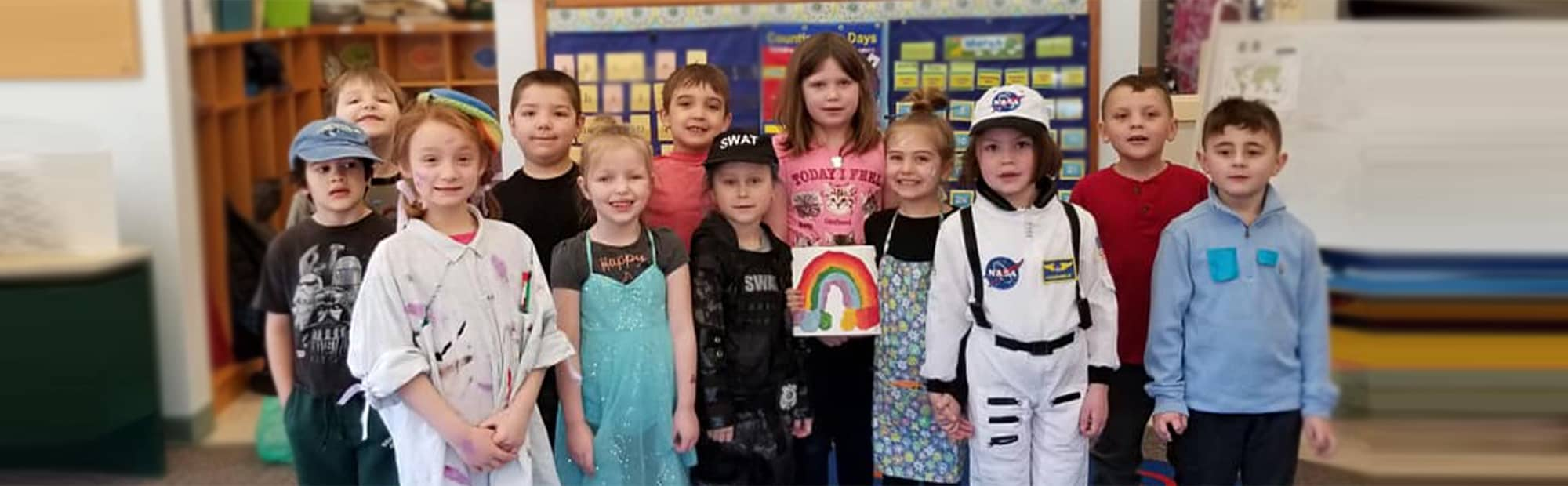 Smiling students in costumes