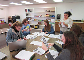 Students working as group at desk