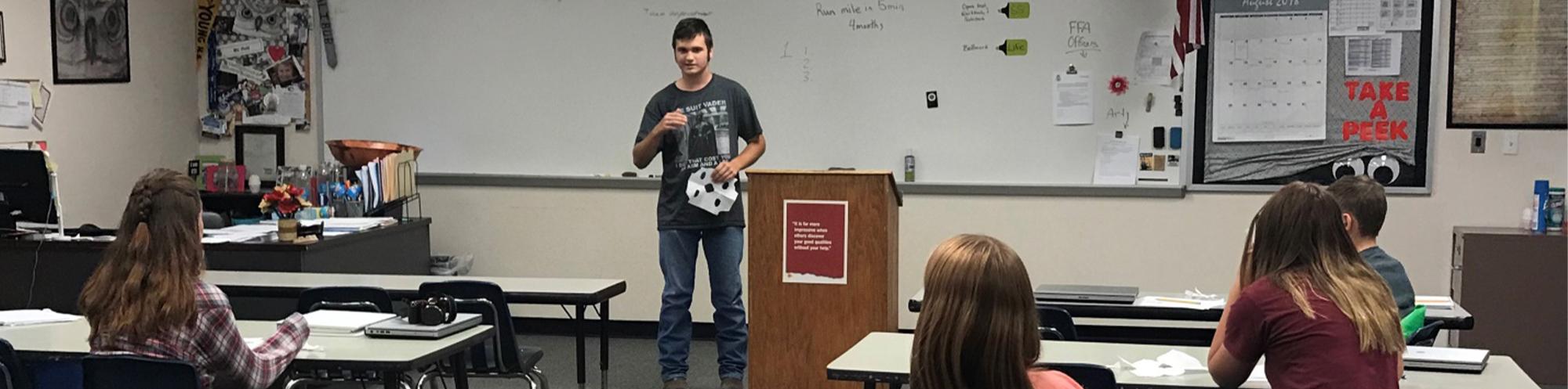 Student giving class presentation