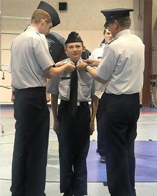 JROTC student receiving pin