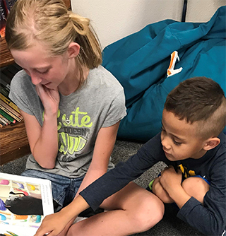 Students reading picture book together