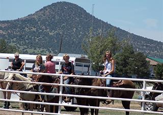 Students riding horses