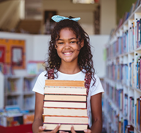 Girls smiling with books