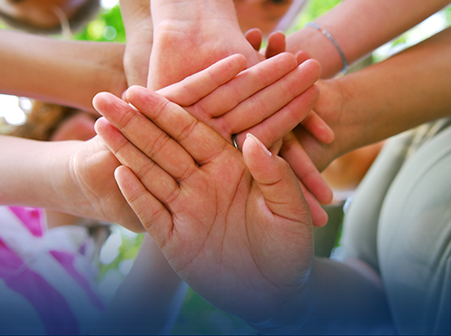 hands in a pile signifying unity