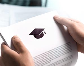 hands holding a grad acceptance letter