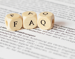 faq letter blocks sitting on a piece of typed paper