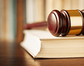 a gavel on top of a book