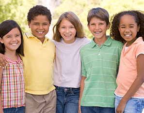 group of elementary students standing together wearing pastel colors