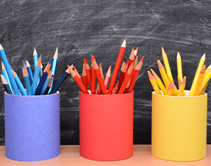 blue, red, and yellow colored pencils in cans