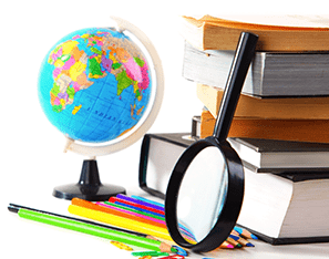 magnify glass, globe, colored pencils, and stack of books
