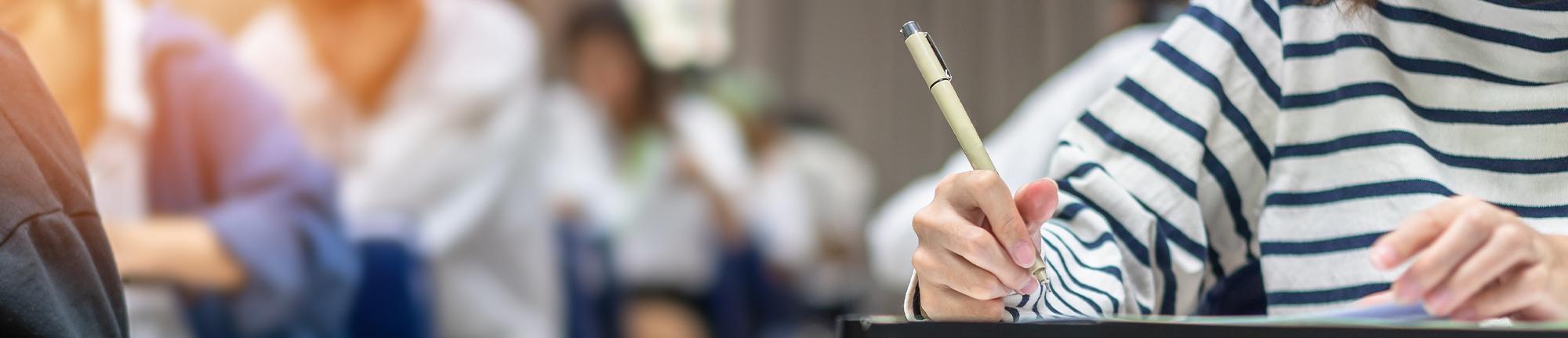 students sitting at desks writing