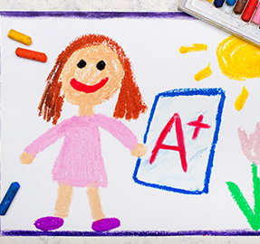 Drawing of a happy school girl next to an A+ grade
