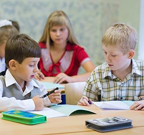 students working on workbook