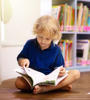 young student in a library reading
