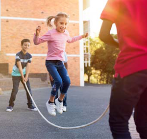 young students with jumprope