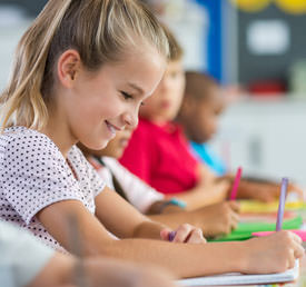 smiling student writing