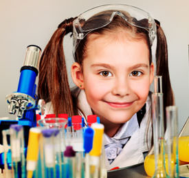 student with microscope and test tubes