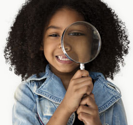 student holding a magnifying glass