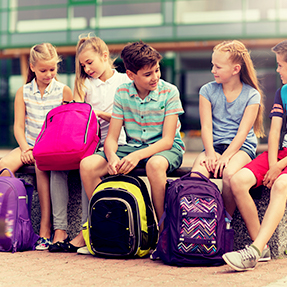 group of students with backpacks