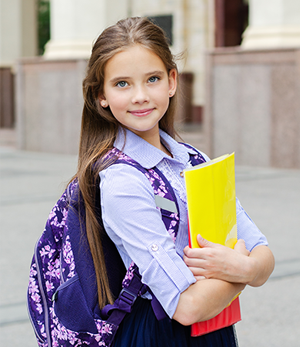 girl with purple backpack