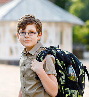 boy with green backpack