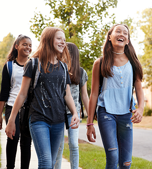 female students walking outside