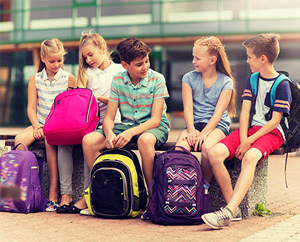 students with backpacks outside