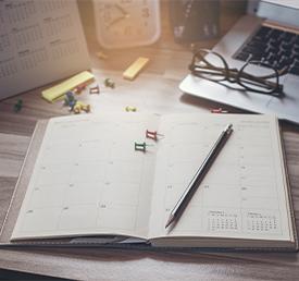 notebook open to a calendar