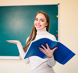 Teacher holding binder