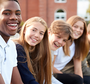 five smiling students