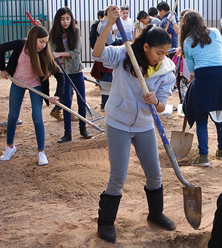 Students dig outside