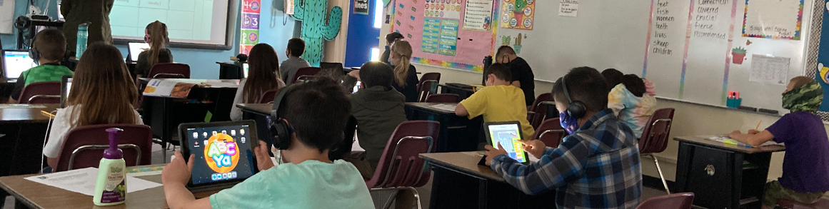 Students in class on tablet devices