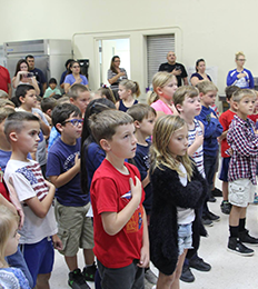 group of students saying the pledge of allegiance