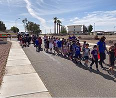 Kids walking in line outside