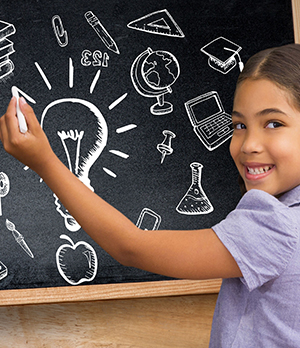 Happy school girl writing on board with an idea light bulb concept