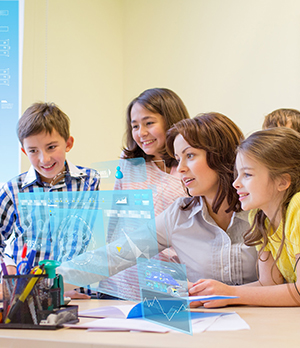 Teacher working with students in front of computer