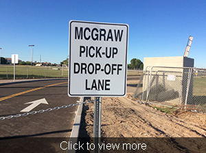 Sign on the pick up lane reading McGraw Pick-Up Drop-Off Lane
