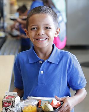 Kindergarten student at lunch