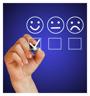 Hand filling out survey with sad face, moderate face, and happy face selected