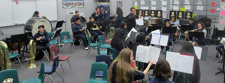 Students in a music class play their instruments