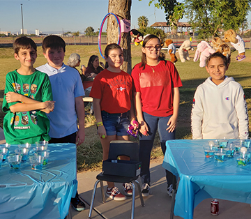 Group of happy WVES students at the school fair
