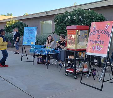 Adult helpers at school fair table