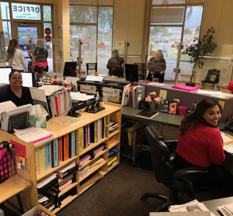 staff members at their desks in the office