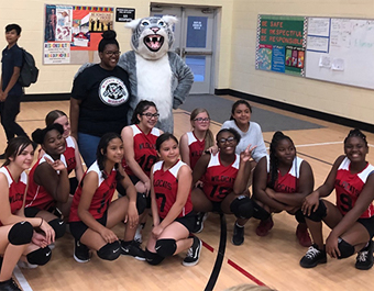 girls volleyball team with the wildcat mascot