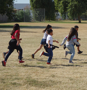 Students running on a field